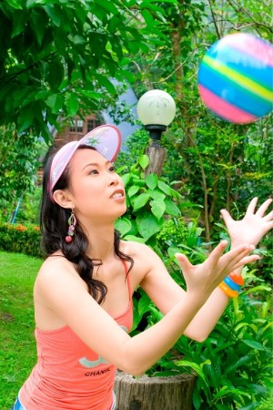 asian girl playing with ball
